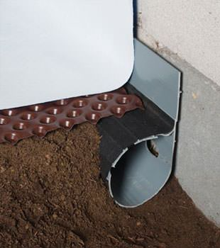 Closeup of a crawl space drainage system installed in Libertyville